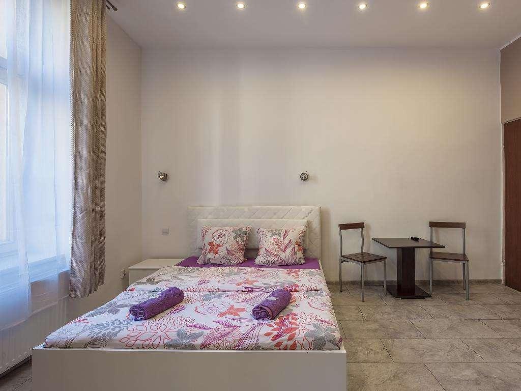 Queen Apartments